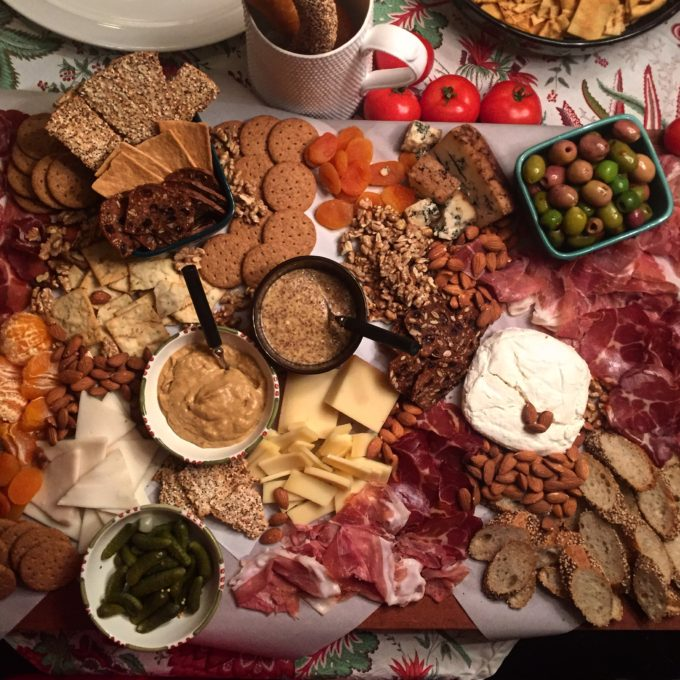 A selection of meats cheeses and crackers for a holiday gathering